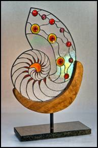 Poseidon's Chalice Free Standing Sculpture in Stained Glass.  Nautilus shell with Blenko rondels on marble stand